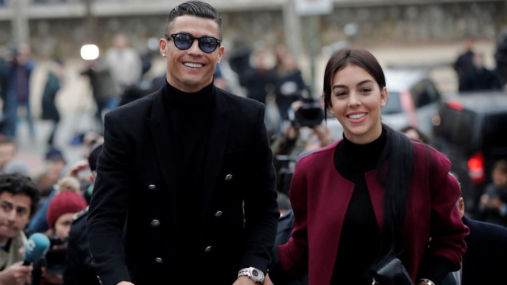 MADRID, SPAIN - JANUARY 22: Famous Portuguese football player Cristiano Ronaldo (L) leaves the provincial court with his girlfriend Georgina Rodriguez (2nd L) after his tax evasion trial in Madrid, Spain on January 22, 2019. Burak Akbulut / Anadolu A