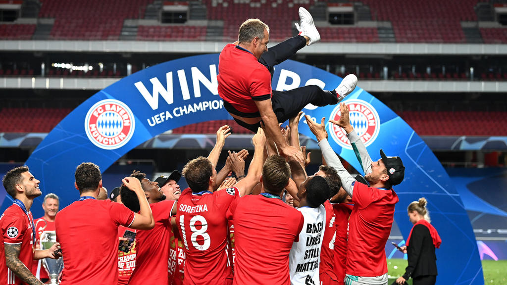 SPPORTUGAL-LISBON-FOOTBALL-UEFA CHAMPIONS LEAGUE-FINALS 200824 -- LISBON, Aug. 24, 2020 Xinhua -- Hans-Dieter Flick top, head coach of FC Bayern Munich, is thrown into the air by his players following their team s victory in the UEFA Champions Leagu