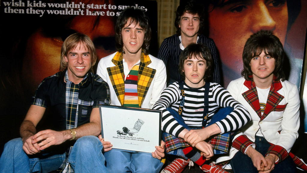 FILE PHOTO: FILE PHOTO DATED 1975 - Derek Longmuir, Alan Longmuir, Les McKeown (back), Ian Mitchell and Stewart Wood during an anti-smoking campaign launch in 1975./File Photo