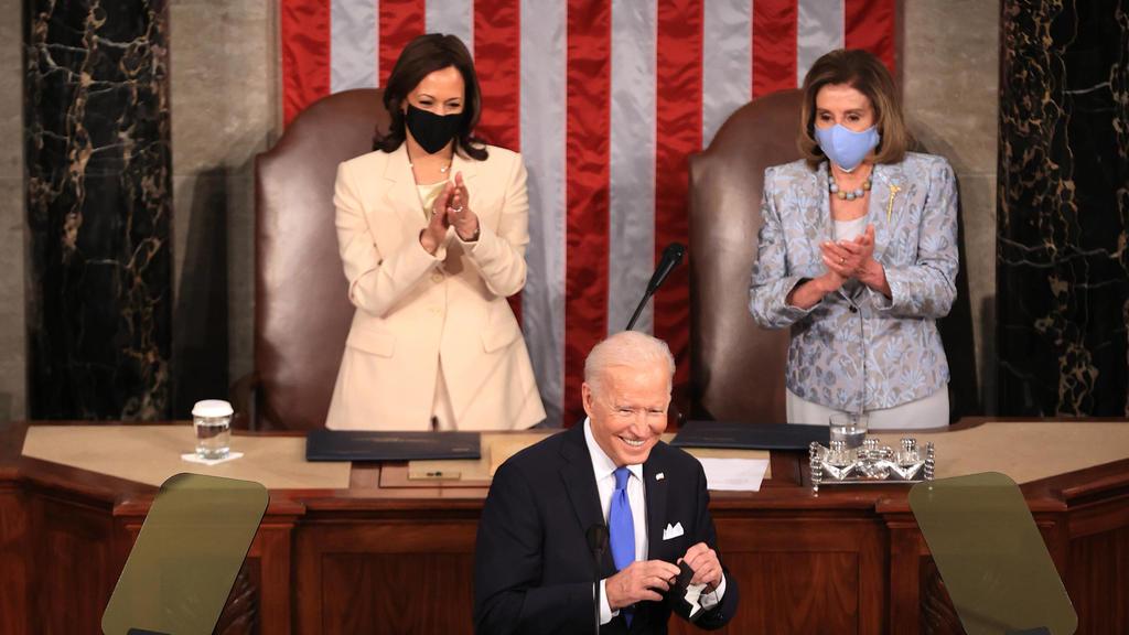 April 28, 2021, Washington, District of Columbia, USA: WASHINGTON, DC - APRIL 28: U.S. President Joe Biden addresses a joint session of congress as Vice President Kamala Harris L and Speaker of the House U.S. Rep. Nancy Pelosi D-CA R look on in the