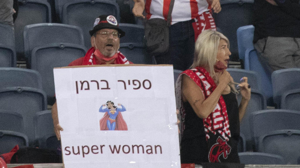 A fan holds a sign with the name of referee Sapir Berman during an Israeli Premier League soccer match between Hapoel Haifa and Beitar Jerusalem in the northern Israeli city of Haifa, Monday, May 3, 2021. Israeli soccer's first transgender soccer ref
