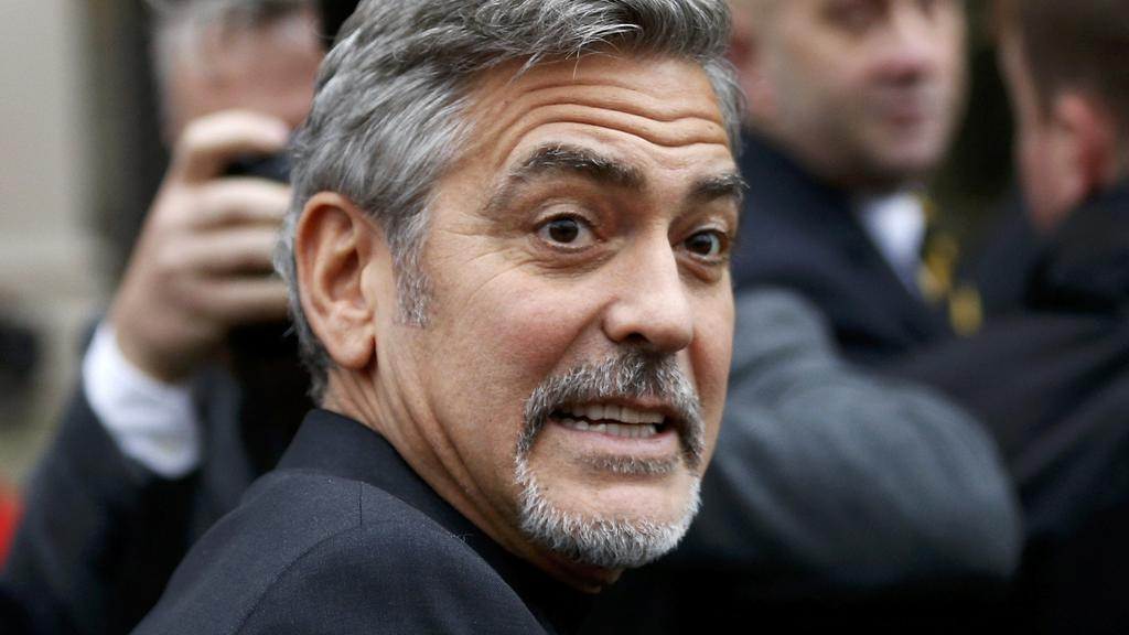 Hollywood actor George Clooney leaves the Post Code Lottery Offices in Edinburgh,Scotland. November 12, 2015. REUTERS/Russell Cheyne