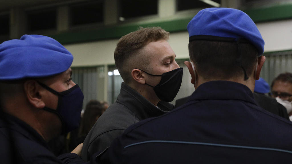 Finnegan Lee Elder leaves after listening to the verdict in the trial for the slaying of an Italian plainclothes police officer in summer 2019, in Rome, Wednesday, May 5, 2021. A jury in Rome on Wednesday convicted two American friends in the 2019 sl