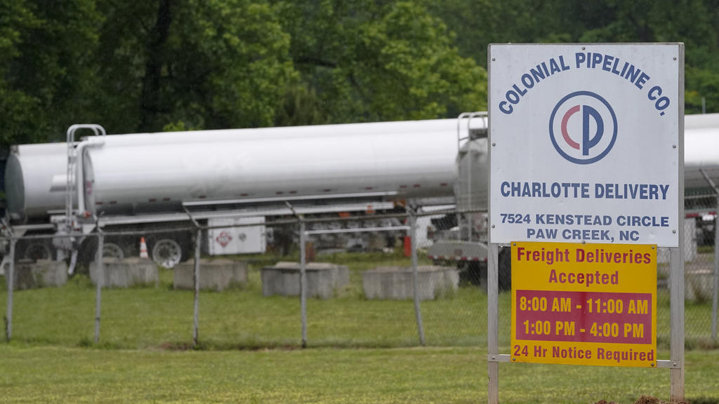 Tanker trucks are parked near the entrance of Colonial Pipeline Company Wednesday, May 12, 2021, in Charlotte, N.C.  Several gas stations in the Southeast reported running out of fuel, primarily because of what analysts say is unwarranted panic-buyin