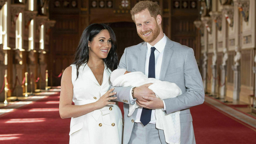 FILE - Britain's Prince Harry and Meghan, Duchess of Sussex, pose with their newborn son Archie Harrison Mountbatten-Windsor in St George's Hall at Windsor Castle, Windsor, south England, on May 8, 2019. It won't be long before Archie is a big brothe