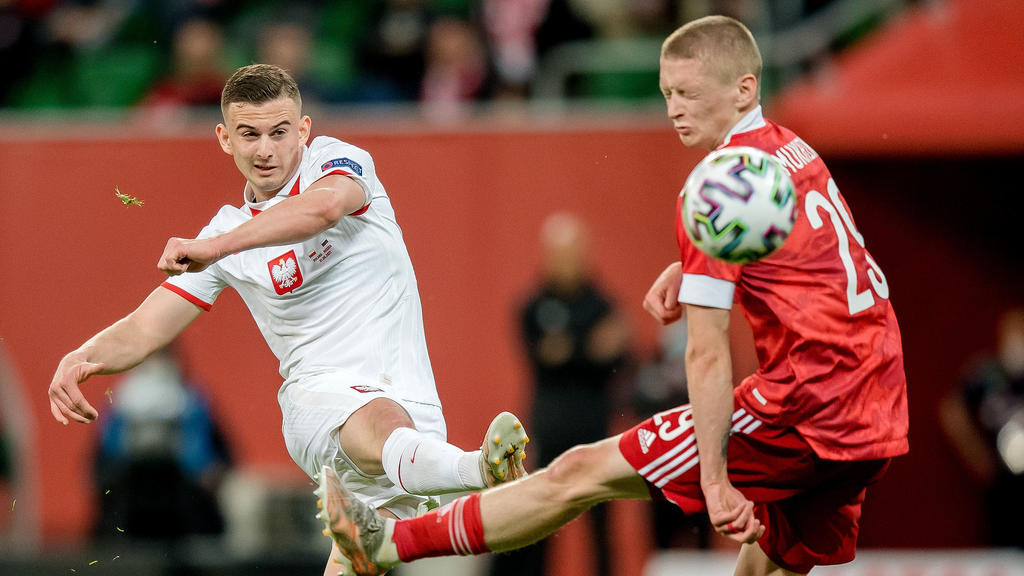 WROCLAW, POLAND - JUNE 01: Kacper Kozlowski (L) of Poland in action with Maksim Mukhin of Russia during the international friendly match between Poland and Russia at the Municipal Stadium on June 01, 2021 in Wroclaw, Poland. (Photo by Thomas Eisenhut