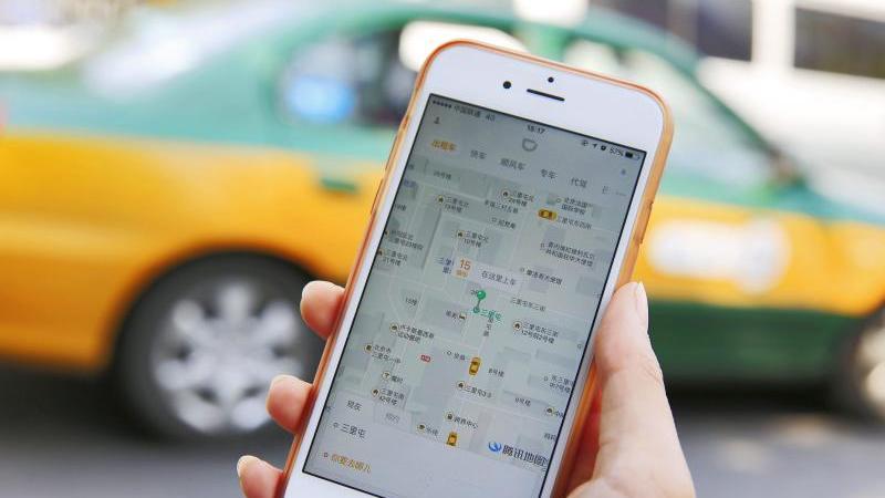 In seinem Heimatmarkt Cina setzte sich Didi in einem erbitterten Preiskampf gegen Uber durch. Foto: How Hwee Young/EPA/dpa
