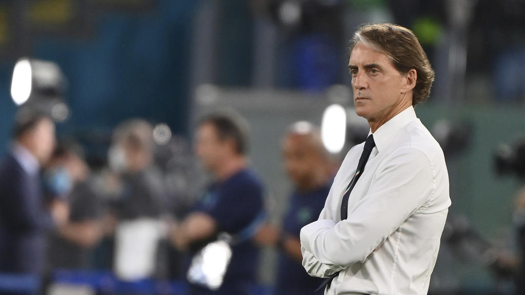 Italy coach Roberto Mancini stands on the pitch prior to the start of the Euro 2020 group A soccer match between Italy and Switzerland, in Rome's Olympic Stadium, Wednesday, June 16, 2021.  (Alfredo Falcone/LaPresse via AP)