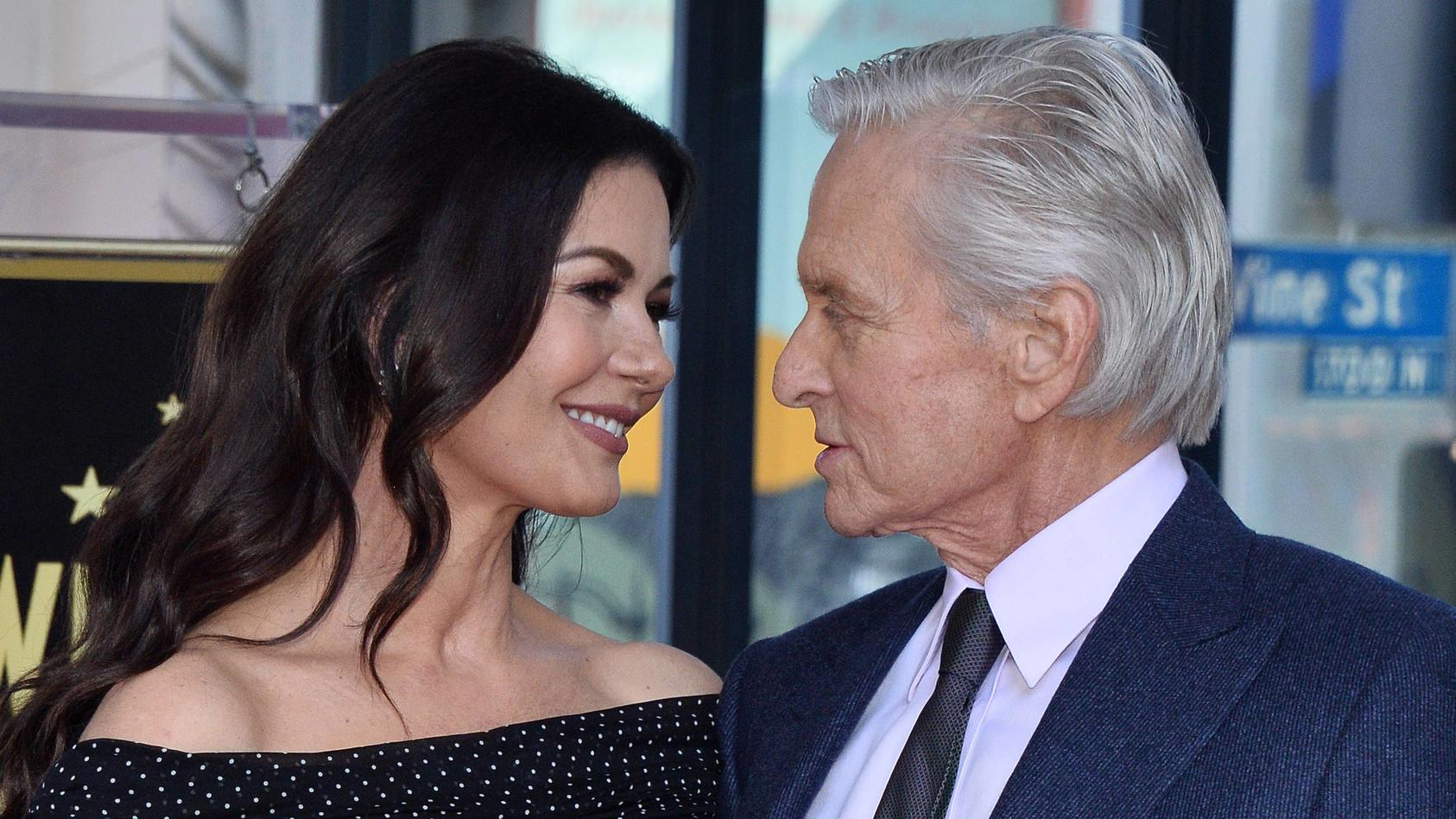 Actor Michael Douglas is joined by his wife actress Catherine Zeta Jones during an unveiling cerem