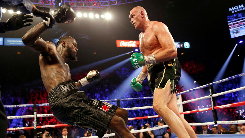 FILE PHOTO: Boxing - Deontay Wilder v Tyson Fury - WBC Heavyweight Title - The Grand Garden Arena at MGM Grand, Las Vegas, United States - February 22, 2020 Tyson Fury knocks down Deontay Wilder during the fight REUTERS/Steve Marcus/File Photo