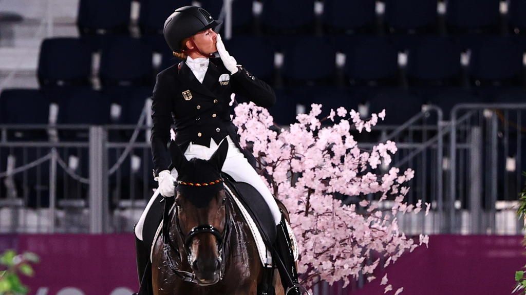 Tokyo 2020 Olympics - Dressage - Individual - Grand Prix - Day 1 - Groups A/B/C - Equestrian Park - Tokyo, Japan - July 24, 2021. Jessica von Bredow-Werndl of Germany on her horse TSF Dalera reacts after competing. REUTERS/Alkis Konstantinidis