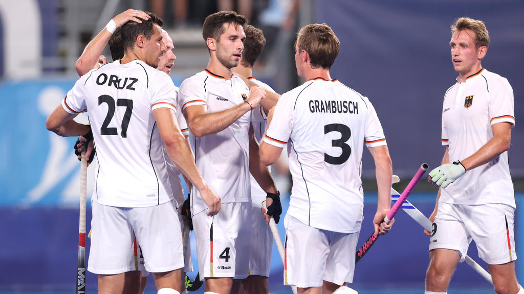 TOKYO, JAPAN - JULY 24: Lukas Windfeder of Team Germany celebrates with teammate Mats Jurgen Grambusch after scoring their team's fourth goal during the Men's Preliminary Pool B match between Canada and Germany on day one of the Tokyo 2020 Olympic Ga