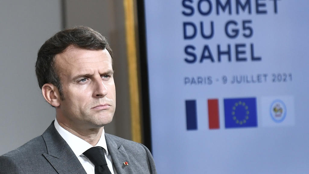 French President Emmanuel Macron attends a press conference after a video summit with leaders of G5 Sahel countries at the Elysee presidential Palace in Paris, Friday July 9, 2021. French President Emmanuel Macron said Friday his country will withdra