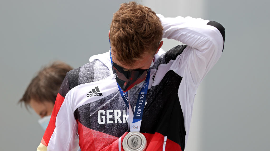 TOKYO, JAPAN - JULY 30:   Silver medalist Hannes Ocik of Team Germany reacts following the medal ceremony for the Men's Eight Final A on day seven of the Tokyo 2020 Olympic Games at Sea Forest Waterway on July 30, 2021 in Tokyo, Japan. (Photo by Naom