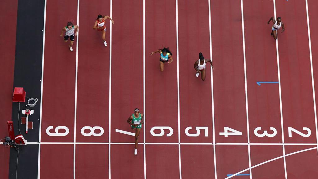 Tokyo 2020 Olympics - Athletics - Women's 100m - Round 1 - OLS - Olympic Stadium, Tokyo, Japan - July 30, 2021. Blessing Okagbare of Nigeria crosses the line to win Heat 6 REUTERS/Pawel Kopczynski