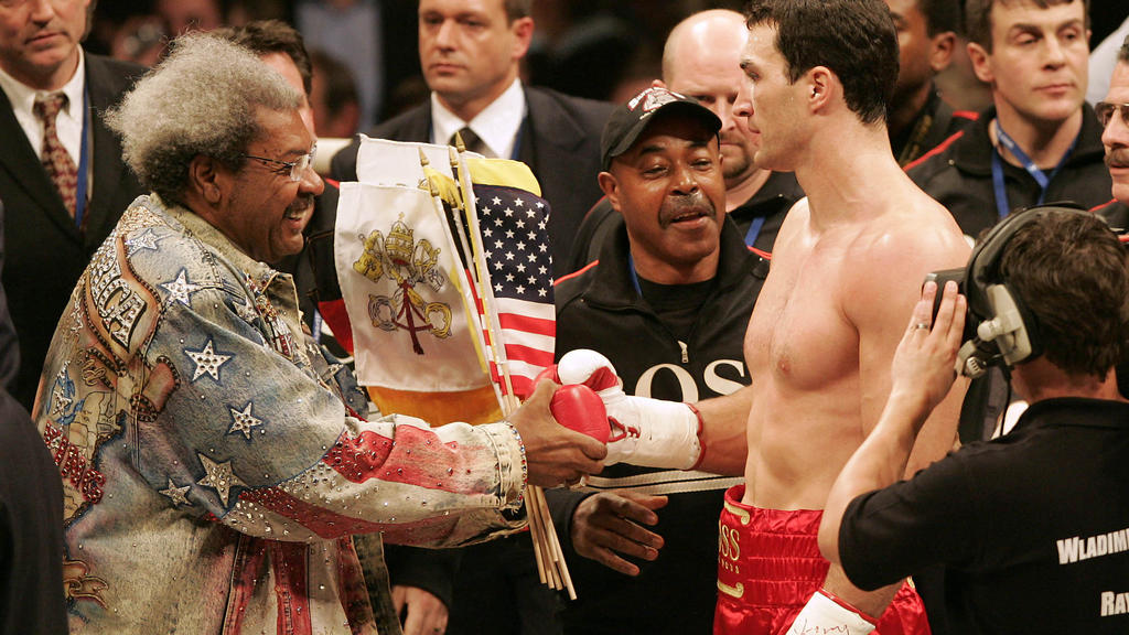 MANNHEIM, GERMANY - MARCH 10: Don King congratulates Wladimir Klitschko for his victory after the IBO and IBF World Heavyweight Championship fight between Wladimir Klitschko of Ukraine and Ray Austin of U.S. at the SAP Arena on March 10, 2007 in Mann