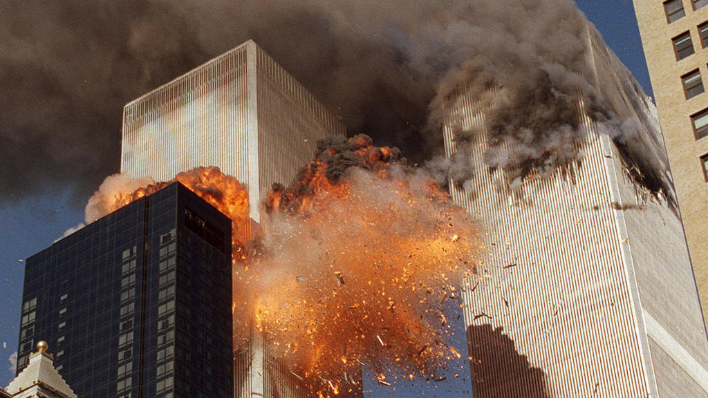 FILE - In this Sept. 11, 2001, file photo, smoke billows from one of the towers of the World Trade Center and flames as debris explodes from the second tower in New York. Relatives of the victims of the Sept. 11 attacks called Thursday, Sept. 2, for