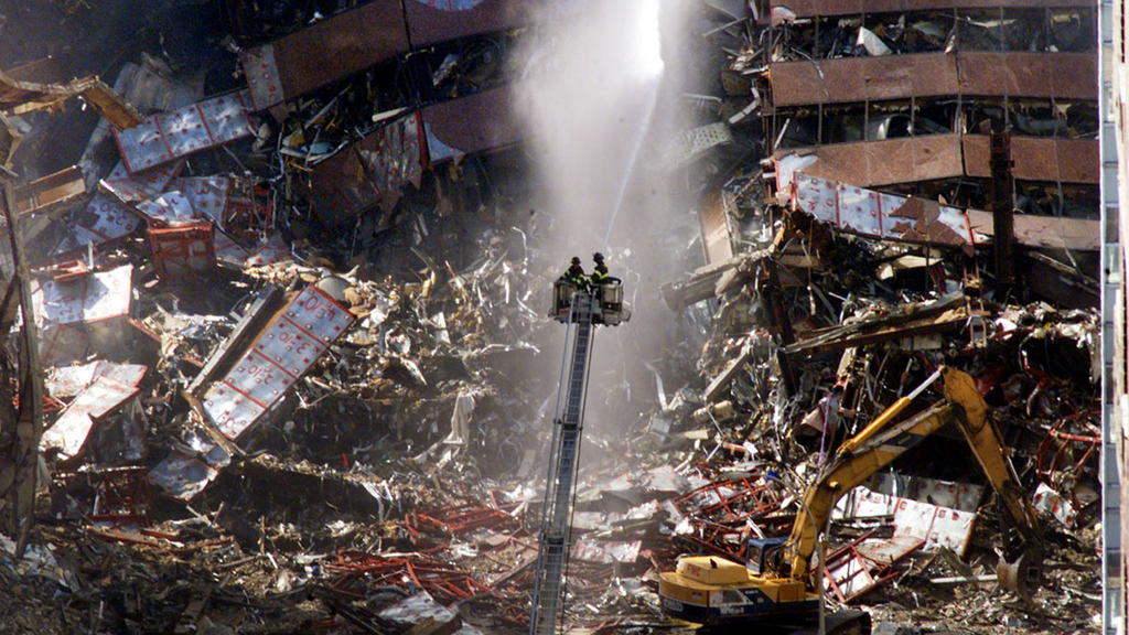 FILE PHOTO: New York City firefighters pour water on the wreckage of 7 World Trade Center in New York, U.S., early September 12, 2001. REUTERS/Mike Segar/File Photo SEARCH 20TH ANNIVERSARY OF THE SEPTEMBER 11 ATTACKS FOR THE PHOTOS