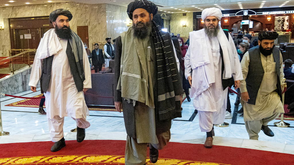 FILE PHOTO: Mullah Abdul Ghani Baradar, the Taliban's deputy leader and negotiator, and other delegation members attend the Afghan peace conference in Moscow, Russia March 18, 2021. Alexander Zemlianichenko/Pool via REUTERS/File Photo/File Photo