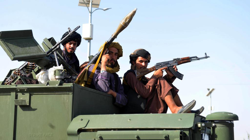 Afghanistan, Taliban in Kandahar 210902 -- KANDAHAR, Sept. 2, 2021 -- Taliban members are seen on a military vehicle on the street in Kandahar city, southern Afghanistan, Sept. 1, 2021. Photo by /Xinhua AFGHANISTAN-KANDAHAR-TALIBAN SanaullahxSeaim PU