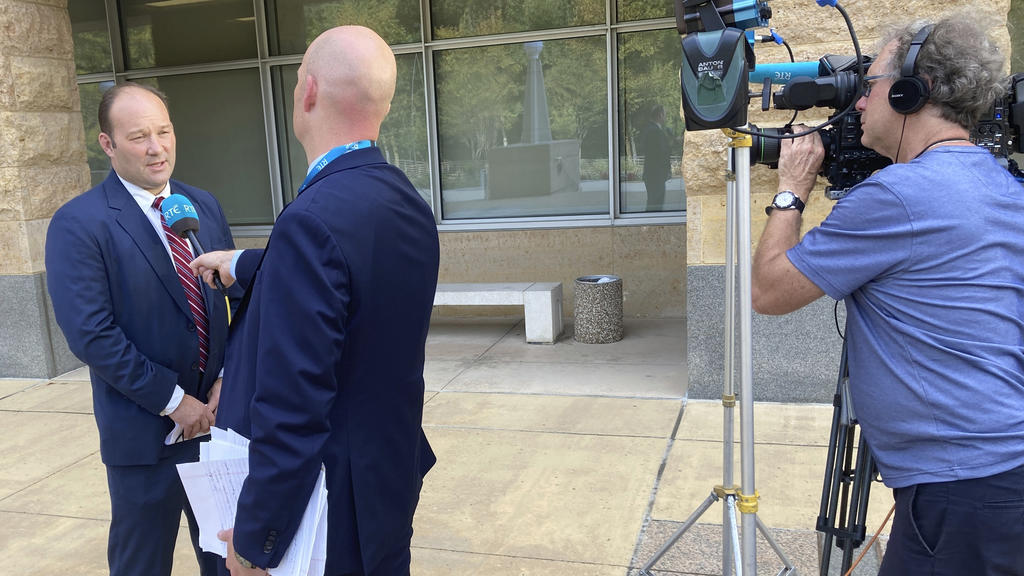 A reporter interviews acting U.S. Attorney Jonathan Lenzner outside the federal courthouse in Greenbelt, Md., on Wednesday, Sept. 15, 2021, after a judge sentenced Eric Eoin Marques to 27 years in prison. U.S. authorities have said Marques, 36, was t