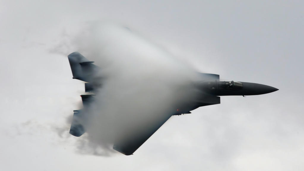 US Air Force F15 jet fighter breaks the sound barrier during a demonstration flight at the 2011 MAKS International Aerospace Show in Zhukovsky