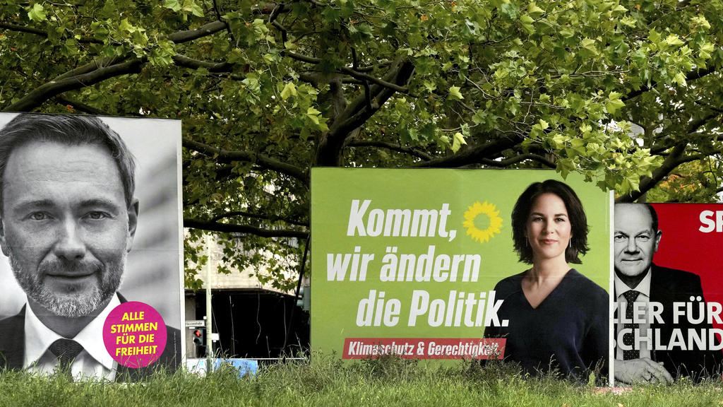 Four elections posters show top candidate of the German Liberals Christian Lindner, left, top candidate for chancellor of the Greens Annalena Baerbock, second left, Social Democratic top candidate for chancellor Olaf Scholz, second right, and Christi