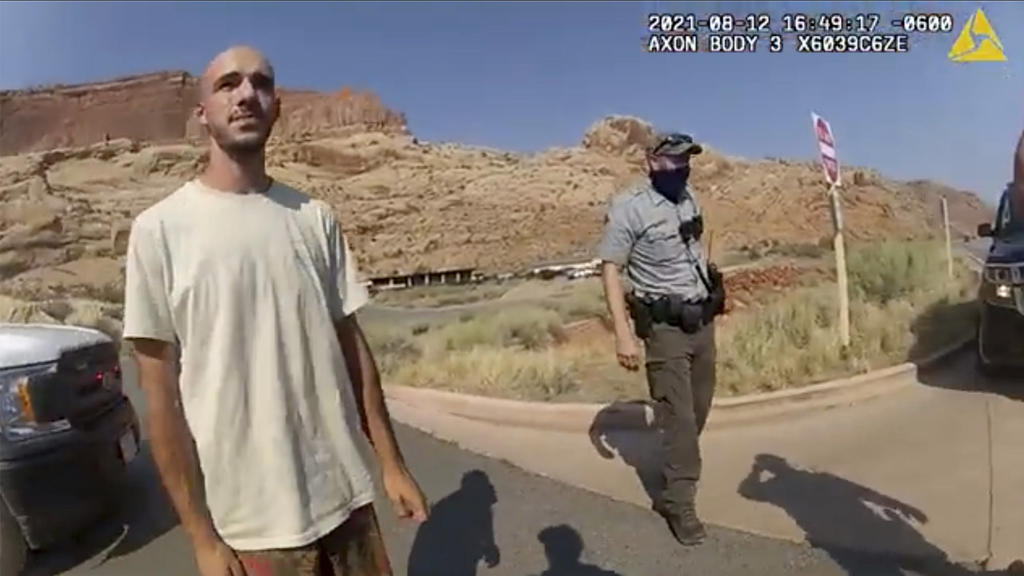 """This police camera video provided by The Moab Police Department shows Brian Laundrie  talking to a police officer after police pulled over the van he was traveling in with his girlfriend, Gabrielle """"Gabby"""" Petito, near the entrance to Arches Nati"""