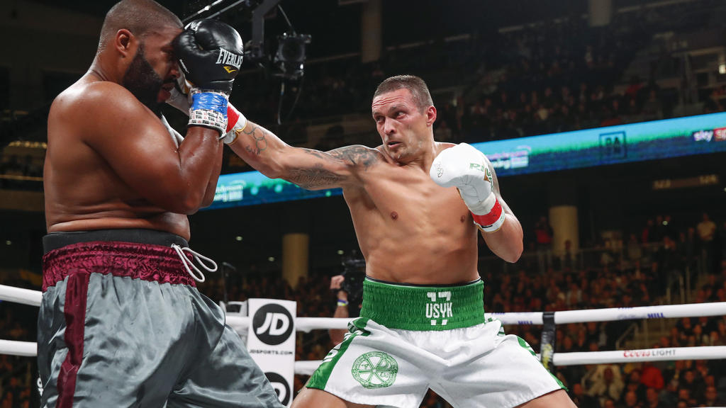 FILE - In this Saturday, Oct. 12, 2019 file photo, Oleksandr Usyk, right, hits Chazz Witherspoon during a heavyweight boxing bout, in Chicago. Usyk is scheduled to take on Anthony Joshua for the heavyweight title, at the London Tottenham Hotspur Stad