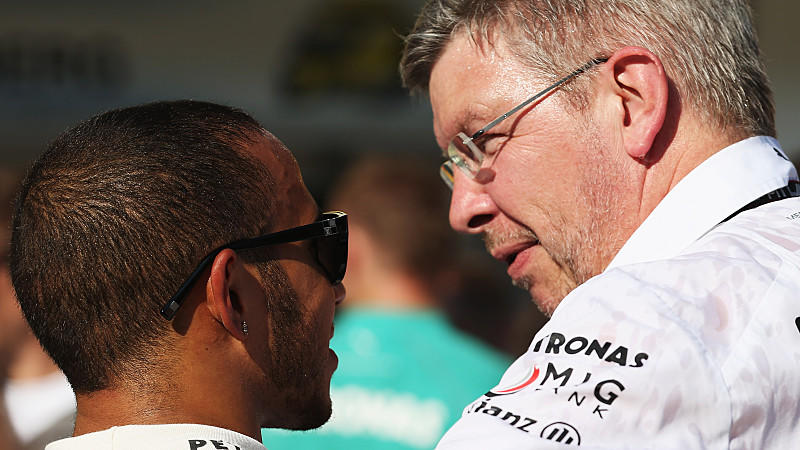 BUDAPEST, HUNGARY - JULY 28:  Lewis Hamilton of Great Britain and Mercedes GP celebrates with Mercedes GP Team Principal Ross Brawn after winning the Hungarian Formula One Grand Prix at Hungaroring on July 28, 2013 in Budapest, Hungary.  (Photo by Ma