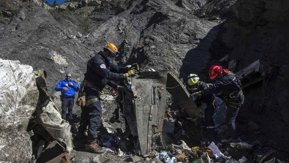 Resuce workers and investigators, seen in this picture made available to the media by the French Interior Ministry April 1, 2015, work near debris from wreckage at the crash site of a Germanwings Airbus A320, near Seyne-les-Alpes. The German pilot, A