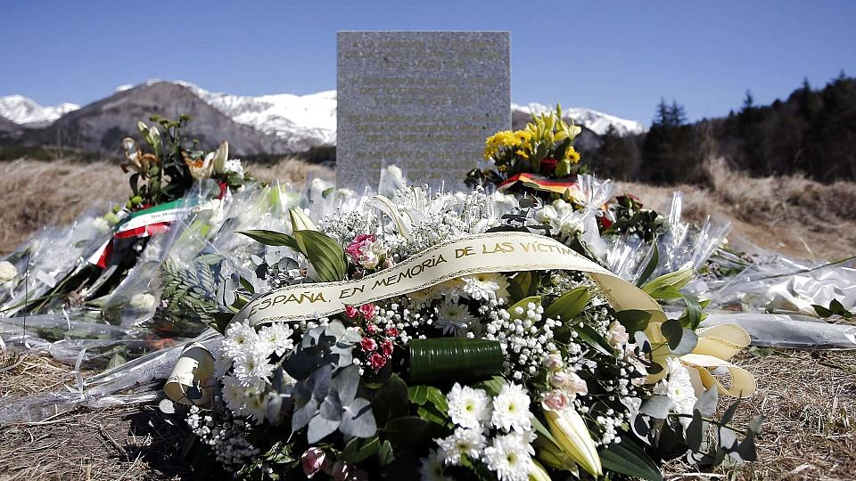A wreath of flowers to the memory of victims from Spain is seen at the memorial for the victims of the air disaster in the village of Le Vernet, near the crash site of the Airbus A320 in French Alps March 27, 2015. A young German co-pilot barricaded