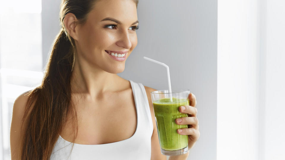 Diet. Healthy Eating Woman Drinking Fresh Raw Green Detox Vegetable Juice. Healthy Lifestyle, Vegetarian Food And Meal. Drink Smoothie. Nutrition Concept.