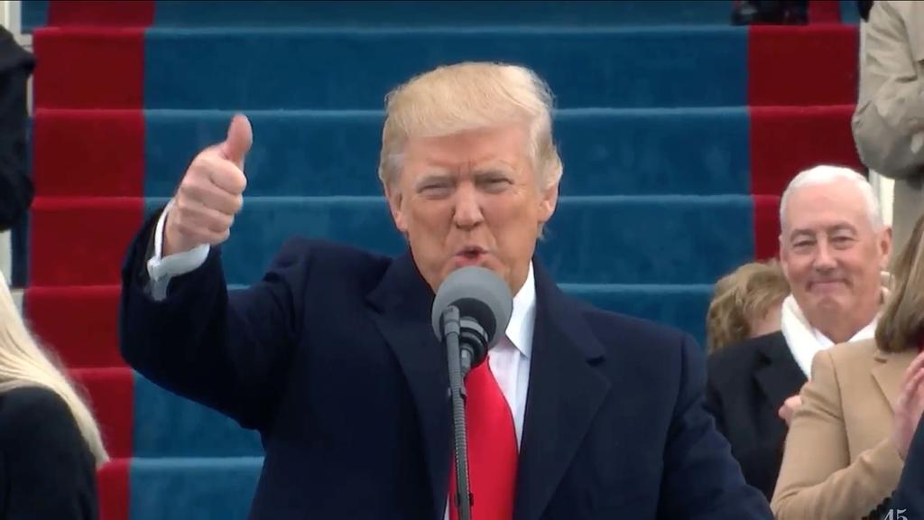 Trump takes the oath of office and steps forward as the 45th President to make his inaugural speech