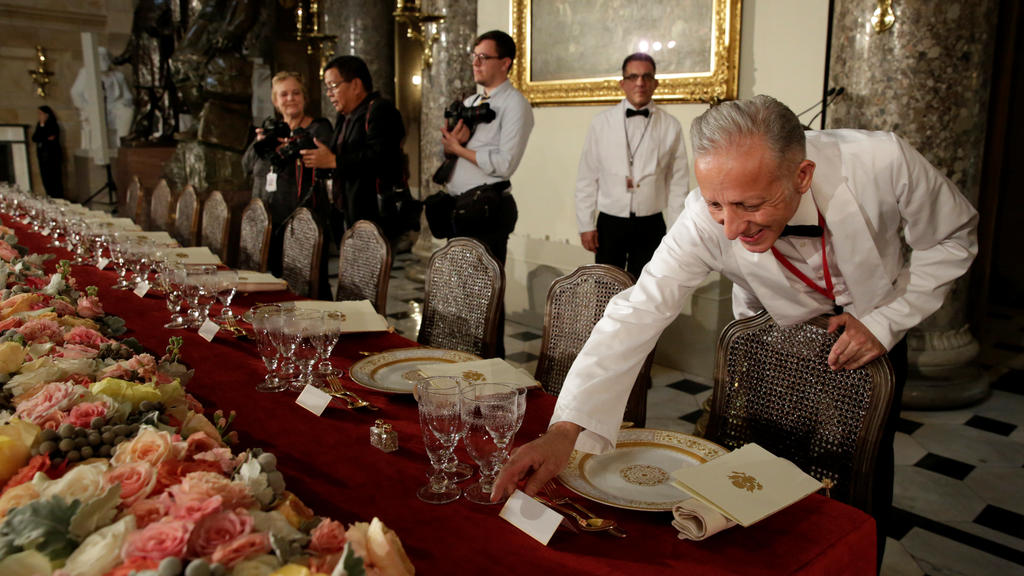 A head waiter puts name tags for U.S. President Donald Trump and members of Congress before the Inaugural Luncheon in Statuary Hall on Capitol Hill in Washington, U.S., January 20, 2017. REUTERS/Yuri Gripas