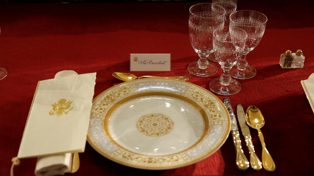 A table is prepared for U.S. President Donald Trump before the Inaugural Luncheon with members of Congress in Statuary Hall on Capitol Hill in Washington, U.S., January 20, 2017. REUTERS/Yuri Gripas