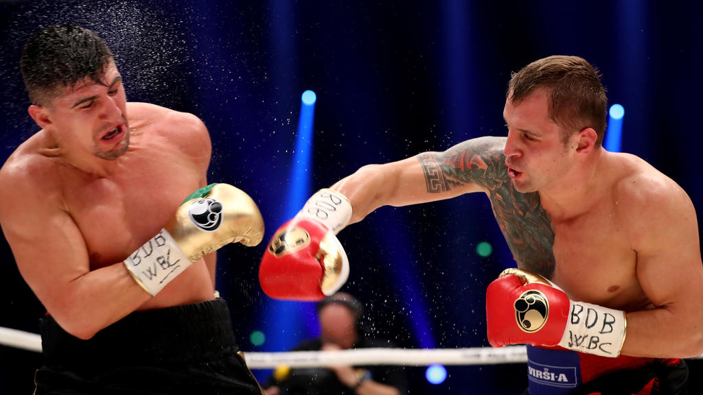DORTMUND, GERMANY - APRIL 01:  Marco Huck (L) of Germany and Mairis Briedis of Latvia exchange punches during their WBC Cruiserweight World Championship title fight at Westfalenhalle on April 1, 2017 in Dortmund, Germany.  (Photo by Martin Rose/Bonga