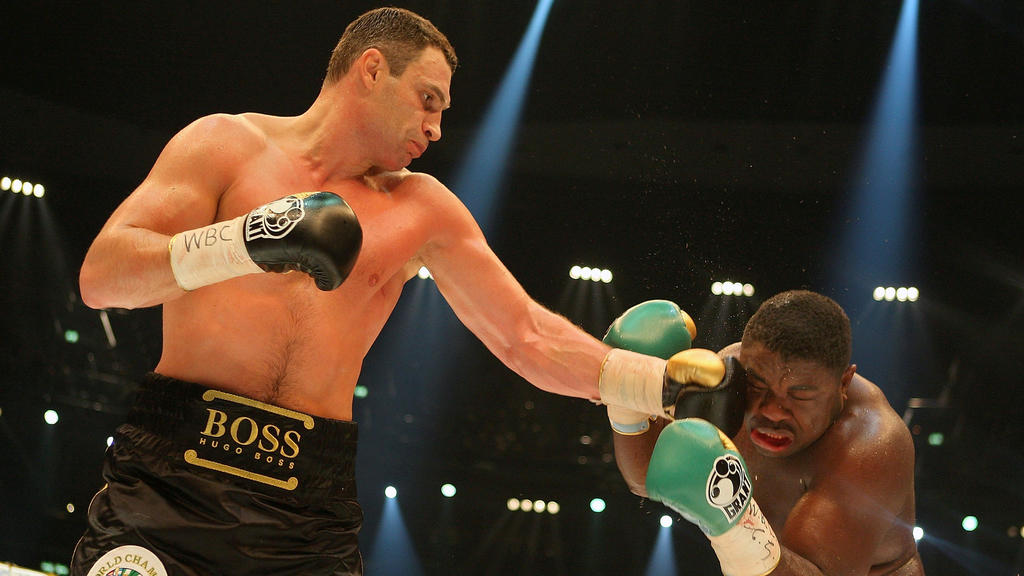 BERLIN - OCTOBER 11: Vitali Klitschko of the Ukraine and Samuel Peter of Nigeria fight during the WBC World Heavyweight Championship at the O2 World on October 11, 2008 in Berlin, Germany. (Photo by Stuart Franklin/Bongarts/Getty Images)