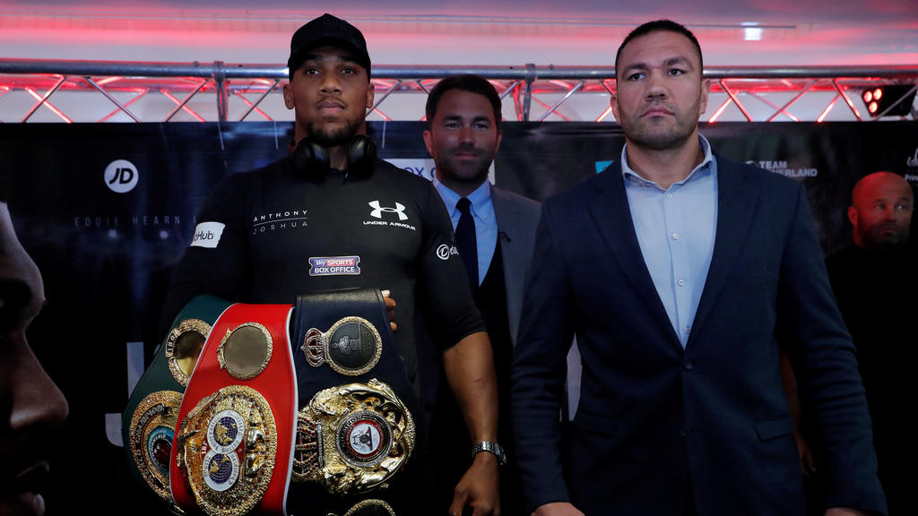 Boxing - Anthony Joshua and Kubrat Pulev Press Conference - Cardiff, Britain - September 11, 2017   Anthony Joshua and Kubrat Pulev pose with promoter Eddie Hearn during the press conference    Action Images via Reuters/Andrew Couldridge