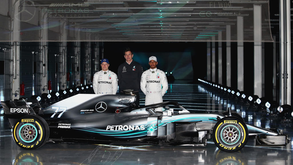 NORTHAMPTON, ENGLAND - FEBRUARY 22:  (l-r) Valtteri Bottas of Finland and Mercedes GP, Mercedes GP Executive Director Toto Wolff and Lewis Hamilton of Great Britain and Mercedes GP pose for a photo with the Mercedes W09 during the launch of the Merce