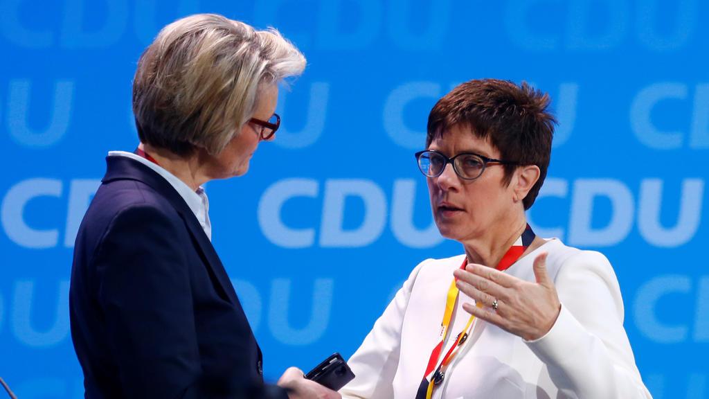 Anja Karliczek talks to Annegret Kramp-Karrenbauer before the Christian Democratic Union (CDU) party congress in Berlin, Germany, February 26, 2018.   REUTERS/Hannibal Hanschke