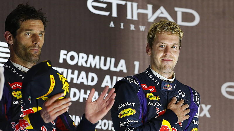 epa03934700 German Formula One driver Sebastian Vettel of Red Bull Racing celebrates on the podium with his teammate Australian Mark Webber (L) after winning the Formula One Grand Prix of Abu Dhabi at the Yas Marina Circuit in Abu Dhabi, United Arab