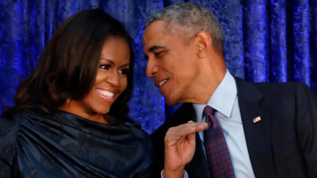 FILE PHOTO: Former U.S. President Barack Obama sits with former first lady Michelle Obama prior to the the unveiling of their portraits at the Smithsonian's National Portrait Gallery in Washington, DC, U.S., February 12, 2018.  REUTERS/Jim Bourg/Fi
